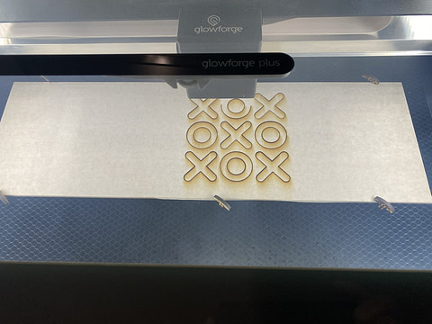 "Laser cutting action of the outer circle of the ""O"" characters."