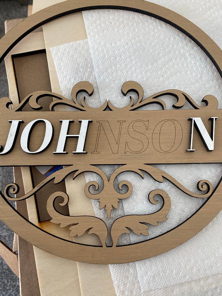 Gluing Name Letters on Front Door Sign Design