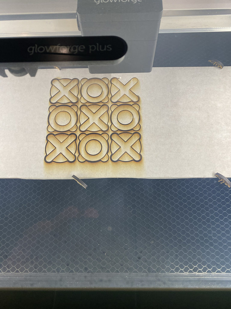 "The laser cut the shapes containing both the ""X"" and ""O"" characters"