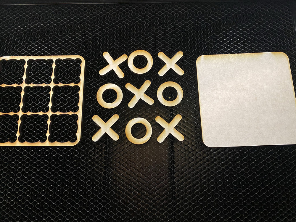 tic-tac-toe board pieces cut out using the laser