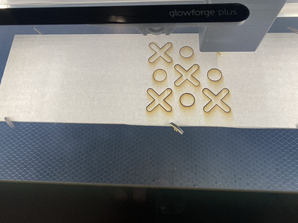 "Laser cutting, the ""X"" 's and the inner circle in the ""O"" 's first."