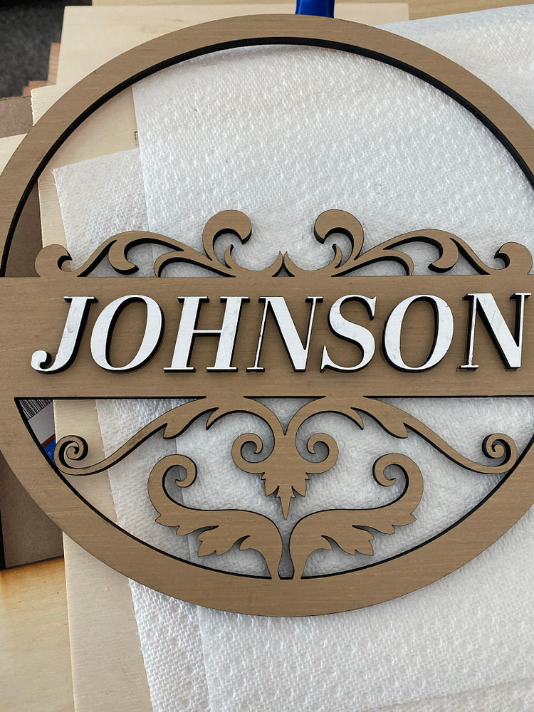 Gluing Remaining Name Letters on Front Door Sign Design
